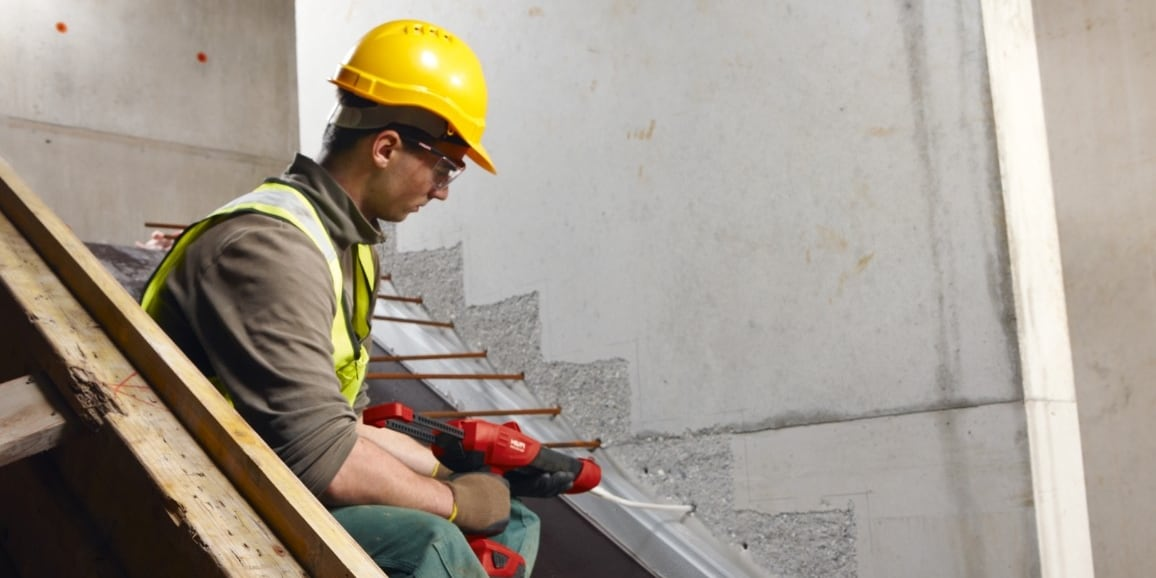 Hilti post installed rebar staircase connected to an existing wall